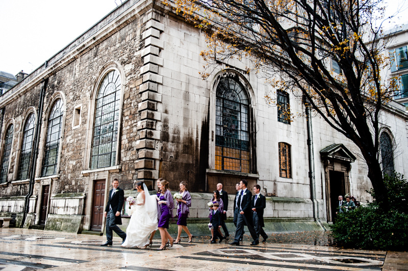 Wedding couple walking from St Lawrence Jury to Guild Hall London