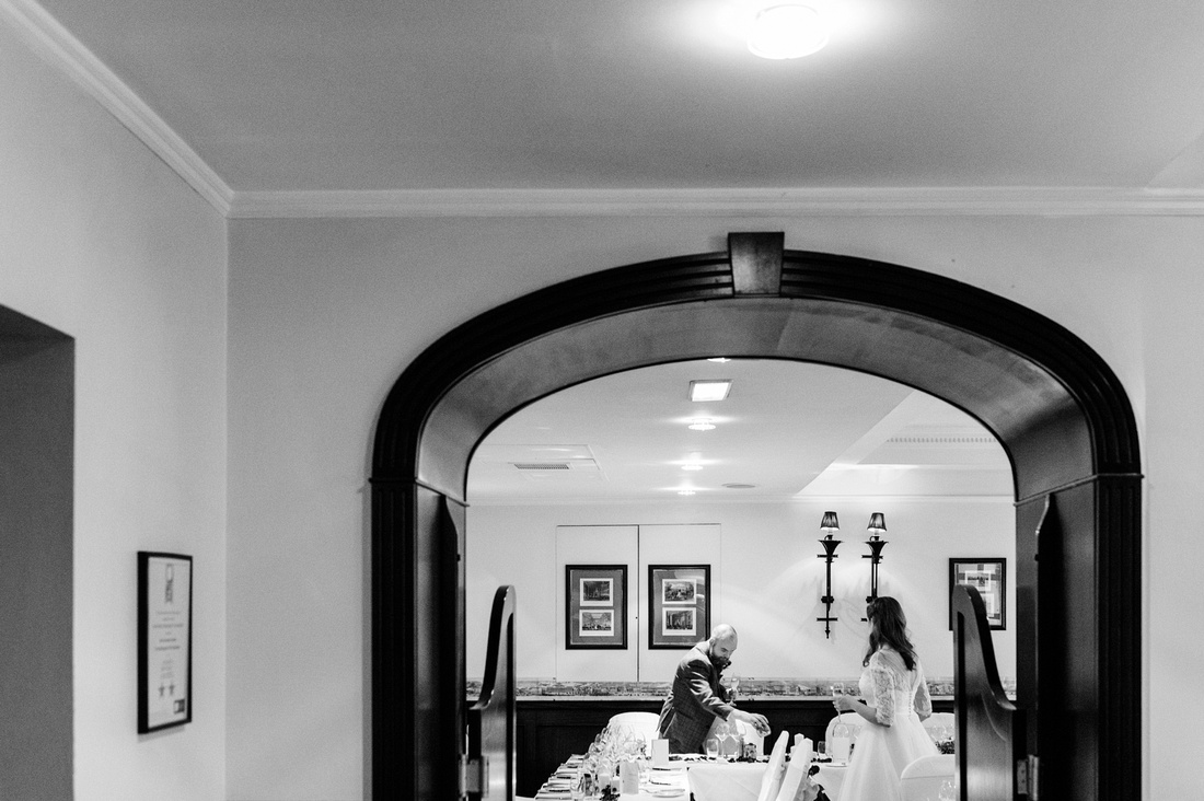 Bride and groom set up the room for their wedding breakfast at The Montague on the Gardens