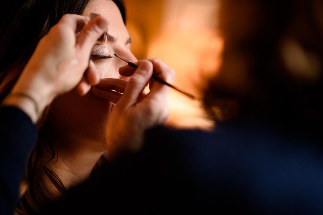 Bride having make up before her weddings at Alpheton Hall Barns suffolk
