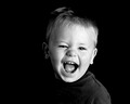 Black and white child portrait with a big smile