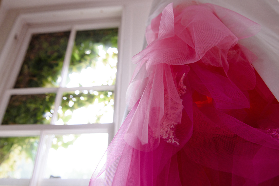 Pink and white wedding dress in window