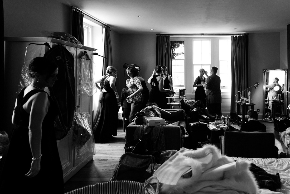 Black and white photo of busy bridal prep at Hotel du vin Tundridge wells