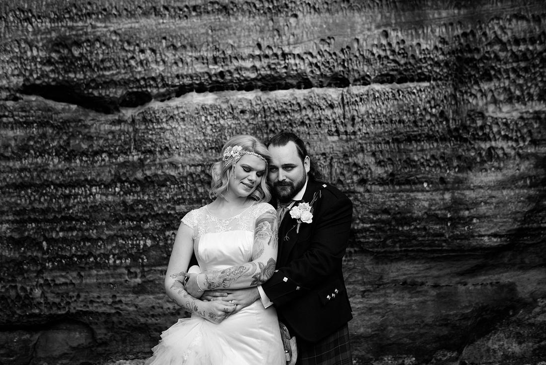 Bride and Groom posing at High Rocks
