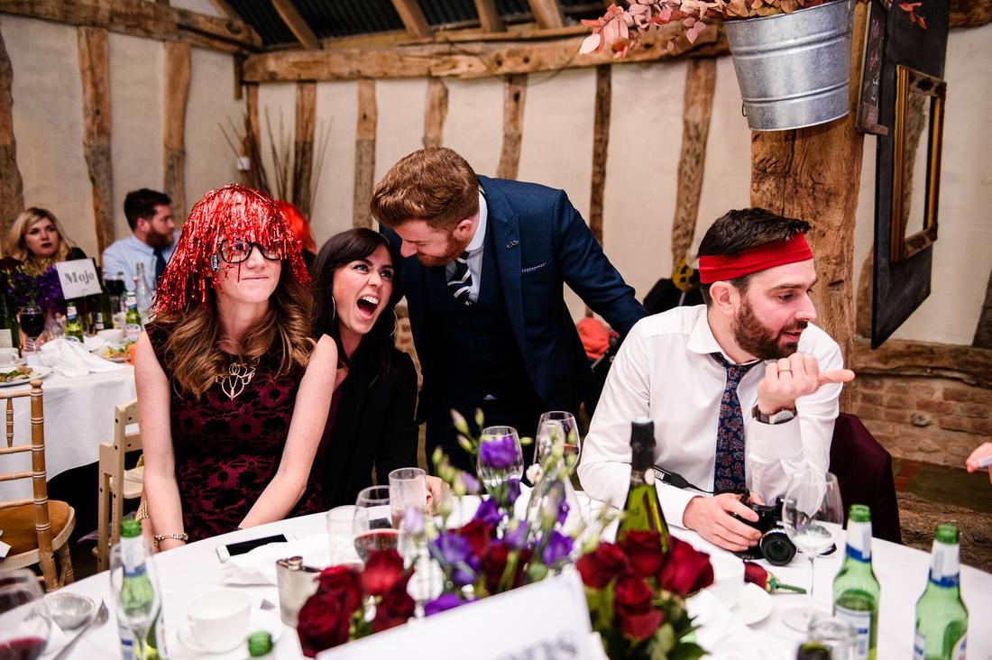 Wedding guests in fancy dress at Alpheton Hall barns