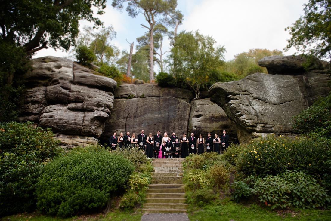 Group photo of bridesmaids and groomsmen at High rock wedding venue, Tunbridge Wells