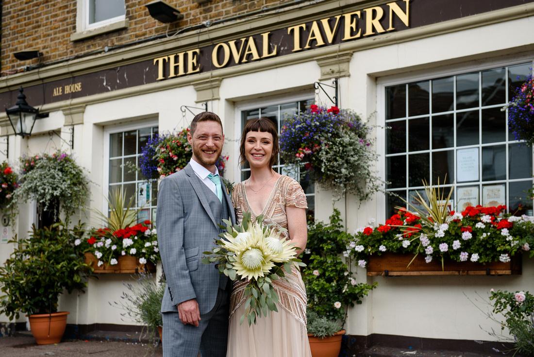 Wedding couple outside The Oval tavern Croydon