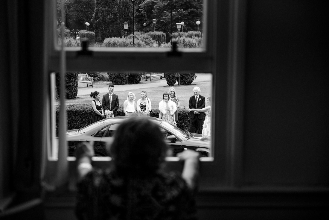 Nan looking out of the window Croydon registry office and seeing the bride before her wedding