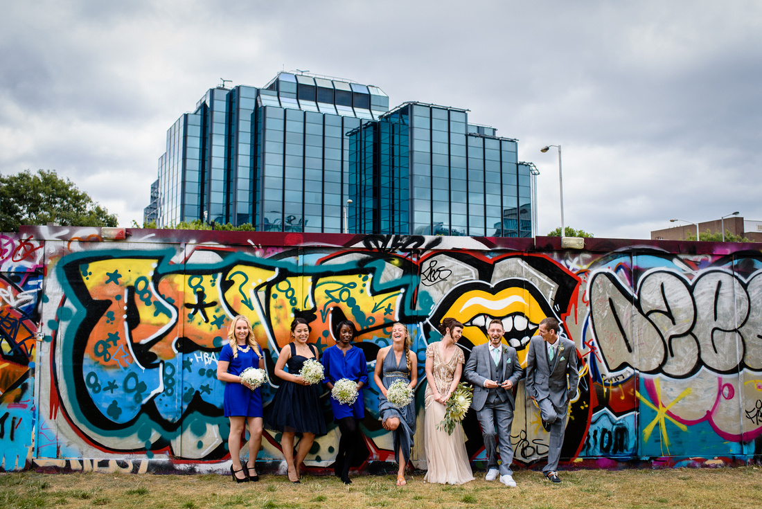 Cool group photo of the bridal party in Croydon